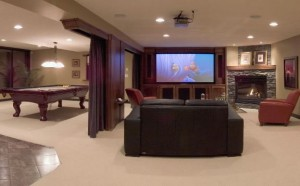 basement-decorating-with-cozy-sofa-billiard-table-and-nice-fireplace-design